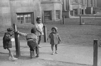0623110 © Granger - Historical Picture ArchiveCHICAGO: CHILDREN, 1941.   Children playing in front of an apartment building on the South Side of Chicago, Illinois. Photograph by Edwin Rosskam, April 1941.