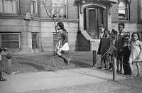 0623111 © Granger - Historical Picture ArchiveCHICAGO: CHILDREN, 1941.   Children jumping rope outside of an apartment building on the South Side of Chicago, Illinois. Photograph by Edwin Rosskam, April 1941.