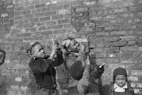 0623115 © Granger - Historical Picture ArchiveCHICAGO: CHILDREN, 1941.   Boys playing and pretending that they are shooting machine guns at a passing airplane, on the South Side of Chicago, Illinois. Photograph by Edwin Rosskam, April 1941.