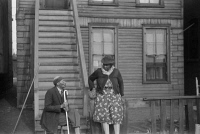 0623117 © Granger - Historical Picture ArchiveCHICAGO: CONVERSATION, 1941.   Two African American woman talking outside of an apartment building on the South Side of Chicago, Illinois. Photograph by Edwin Rosskam, April 1941.