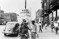 0623127 © Granger - Historical Picture ArchiveCHICAGO: PROTEST, 1941.   A picket line protesting low wages for African Americans, outside of Mid-City Realty Company on the South Side of Chicago, Illinois. Photograph by John Vachon, July 1941.