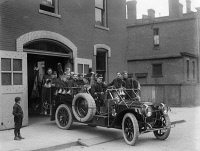 0527613 © Granger - Historical Picture ArchiveDETROIT: FIRETRUCK, 1911.   A fire brigade aboard a fire engine manufactured by the Packard Motor Car Company in Detroit, Michigan. Photograph, May 1911.