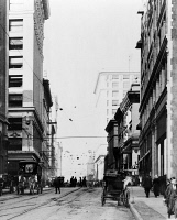 0623473 © Granger - Historical Picture ArchiveLOS ANGELES: STREET SCENE.   Street scene with horse drawn carriages in Los Angeles, California. Photograph, late 19th or early 20th century.