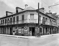 0131773 © Granger - Historical Picture ArchiveNEW ORLEANS: STOREFRONT.   Exterior view of a grocery store at 701 Bourbon Street, on the corner of St. Peter Street, New Orleans, Louisiana. Photographed by Frances Benjamin Johnston, c1938.