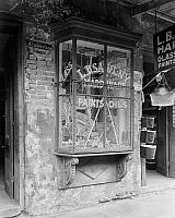 0131774 © Granger - Historical Picture ArchiveNEW ORLEANS: STOREFRONT.   Exterior view of a hardware store at 906 Bourbon Street, New Orleans, Louisiana. Photographed by Frances Benjamin Johnston, c1938.