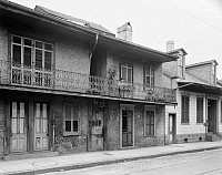 0131775 © Granger - Historical Picture ArchiveNEW ORLEANS: BUILDING.   Exterior view of the building at 907-909 Bourbon Street, New Orleans, Louisiana. Photographed by Frances Benjamin Johnston, c1938.