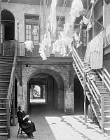 0132634 © Granger - Historical Picture ArchiveNEW ORLEANS: SONIAT HOUSE.   Laundry drying on clotheslines in the courtyard of the Joseph Soniat Dufossat house at 1133 Chartres Street in New Orleans, Louisiana. Photographed by Frances Benjamin Johnston, c1938.