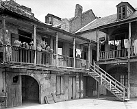 0133506 © Granger - Historical Picture ArchiveNEW ORLEANS: HOUSE.   A view from the courtyard of the house at 620-621 Governor Nicholls Street in New Orleans, Louisiana. Photographed by Frances Benjamin Johnston, c1938.