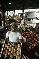 0162708 © Granger - Historical Picture ArchiveNEW ORLEANS: MARKET.   A boy carrying a crate of peaches at the French Market in New Orleans, Louisiana. Photographed c1974.