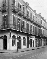 0162891 © Granger - Historical Picture ArchiveNEW ORLEANS: BUILDINGS.   The Brigot Buildings at 601-605 Royal Street in New Orleans, Louisiana, viewed from the Toulouse Street interesection. Photographed by Frances Benjamin Johnston, c1938.