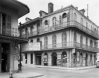 0162897 © Granger - Historical Picture ArchiveNEW ORLEANS: STOREFRONTS.   A view of the Royal Furniture Shop (left) and the G. Napolitano Grocery on the corner of Royal and Dumaine Streets in New Orleans, Louisiana. Photographed by Frances Benjamin Johnston, c1938.