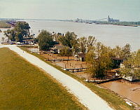0163220 © Granger - Historical Picture ArchiveNEW ORLEANS: FLOOD.   A row of houses built on pilings along the Mississippi River, approaching flood level, in New Orleans, Louisiana. Photographed in 1973.
