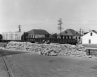 0163548 © Granger - Historical Picture ArchiveNEW ORLEANS: FLOOD WALL.   Workmen building a wall of sandbags near the waterfront in New Orleans, Louisiana, to help guard against flooding during a period of high waters on the Mississippi River. Photographed in 1974.