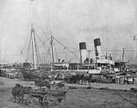 0353235 © Granger - Historical Picture ArchiveNEW ORLEANS, c1890.   Loading cotton onto a steamer in New Orleans, Louisiana. Photograph, c1890.