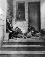 0002754 © Granger - Historical Picture ArchiveNYC: TENEMENT LIFE.  Boys sleeping on the porch of a tenement building in New York City. Photograph by Jacob Riis, c1890.