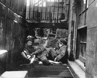 0031170 © Granger - Historical Picture ArchiveRIIS: NEW YORK, 1901.   Young street Arabs sleeping on a steam grate from an underground newspaper press room for warmth. Photograph, c1901, by Jacob Riis.