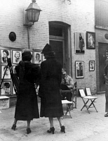 0067397 © Granger - Historical Picture ArchiveGREENWICH VILLAGE, c1950.   Streetscene in Macdougal Alley of an outdoor art exhibit, c1950.