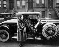 0078517 © Granger - Historical Picture ArchiveNEW YORK: HARLEM, 1932.   Harlem couple wearing raccoon coats. Photograph by James Van Der Zee, 1932.