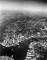 0092042 © Granger - Historical Picture ArchiveMANHATTAN, c1962.   Site of the proposed World Trade Center in Lower Manhattan. Aerial view, early 1960s, showing piers along the waterfront in Manhattan and Brooklyn.