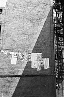 0092277 © Granger - Historical Picture ArchiveNEW YORK: LOWER EAST SIDE.   Clothesline on the side of a tenement building on the Lower East Side, New York. Photographed c1960.