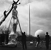 0108961 © Granger - Historical Picture ArchiveNEW YORK: WORLD'S FAIR.   Workers install 'Freedom of the Press, one of Leo Friedlander's 'Four Freedoms' statues, at the New York City World's Fair, 1939; in the background are the trylon and perisphere.