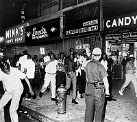 0116487 © Granger - Historical Picture ArchiveHARLEM: RACE RIOT, 1964.   Rioters march through Harlem streets protesting the fatal shooting of African American teenager James Powell by NYPD Lieutenant Thomas Gilligan. Photograph by Dick De Marsico, 1964.