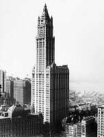 0124747 © Granger - Historical Picture ArchiveWOOLWORTH BUILDING, c1935.   The Woolworth Building, completed in 1913, in lower Manhattan. Hudson River piers can be seen in the background.