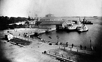 0124779 © Granger - Historical Picture ArchiveCASTLE GARDEN, c1880.   A view of Battery Landing, at the southern tip of Manhattan in New York City, and Castle Garden, the city's immigration station from 1855 to 1890. Photographed c1880.