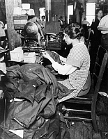 0125133 © Granger - Historical Picture ArchiveNEW YORK: SWEATSHOP, c1915.   Woman garment worker in an unidentified New York Sweatshop, c1915.