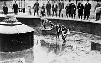 0126690 © Granger - Historical Picture ArchiveNEW YORK: FOUNTAIN, 1908.   Four newsboys catching goldfish in a fountain at Union Square Park in New York City, December 1908.