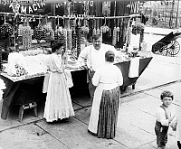 0130824 © Granger - Historical Picture ArchiveNEW YORK: LITTLE ITALY, c1905.   Women shopping at a street vendor's table in Little Italy, New York City. Photograph, c1905.