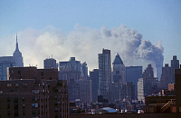 0169986 © Granger - Historical Picture ArchiveNEW YORK: SEPTEMBER 11TH.   The burning towers of the World Trade Center in lower Manhattan, following the terrorist attack on 11 September 2001.