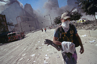 0170006 © Granger - Historical Picture ArchiveNEW YORK: SEPTEMBER 11TH.   A rescue worker with a bandana over his face on an ash-covered street in lower Manhattan, after the terrorist attack on the World Trade Center on 11 September 2001.