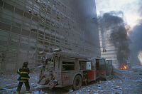 0170008 © Granger - Historical Picture ArchiveNEW YORK: SEPTEMBER 11TH.   A firefigher pulls the hose off a fire engine on an ash-covered street in lower Manhattan, after the terrorist attack on the World Trade Center on 11 September 2001.