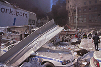 0170011 © Granger - Historical Picture ArchiveNEW YORK: SEPTEMBER 11TH.   Debris and ash-covered police cars in lower Manhattan, after the terrorist attack on the World Trade Center on 11 September 2001.