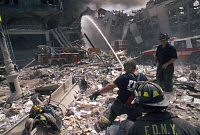 0170015 © Granger - Historical Picture ArchiveNEW YORK: SEPTEMBER 11TH.   A team of firefighters extinguish a fire on a debris-covered street in lower Manhattan, after the terrorist attack on the World Trade Center on 11 September 2001.
