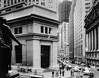 0216506 © Granger - Historical Picture ArchiveNEW YORK: STOCK EXCHANGE.   A view of the intersection of Broad and Wall Streets in Lower Manhattan, New York City, showing the Morgan Guaranty Trust Company Building (center) and the New York Stock Exchange (right), as seen from the steps of the Federal Hall Memorial (formerly the Sub-Treasury Building). Photographed c1960.