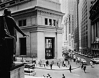 0216507 © Granger - Historical Picture ArchiveNEW YORK: STOCK EXCHANGE.   A view of the intersection of Broad and Wall Streets in Lower Manhattan, New York City, showing the Morgan Guaranty Trust Company Building (center) and the New York Stock Exchange (right), as seen from the steps of the Federal Hall Memorial (formerly the Sub-Treasury Building). Photographed c1960.