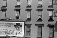 0268353 © Granger - Historical Picture ArchiveEVANS: NEW YORK, 1938.   A billboard on the tenement buildings on 61st Street, between 1st and 3rd Avenues in New York, New York. Photograph by Walker Evans, 1938.