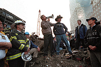 0268369 © Granger - Historical Picture ArchiveBUSH AT GROUND ZERO. President George W. Bush, with retired New York City firefighter Bob Beckwith, visits rescue workers at the site of the World Trade Center following the September 11, 2001 attacks. Photograph by Eric Draper, 14 September 2001.
