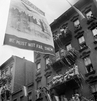 0323849 © Granger - Historical Picture ArchiveNEW YORK: MOTT STREET, 1942.   A flag raising ceremony on Mott Street in New York City, in honor of men from the neighborhood in the United States Army. Photograph by Marjory Collins, 1942.