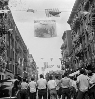 0323850 © Granger - Historical Picture ArchiveNEW YORK: MOTT STREET, 1942.   A flag raising ceremony on Mott Street in New York City, in honor of men from the neighborhood in the United States Army. Photograph by Marjory Collins, 1942.