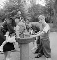 0352186 © Granger - Historical Picture ArchiveCENTRAL PARK, 1942.   A family at the drinking fountain in Central Park in New York City. Photograph by Marjory Collins, 1942.
