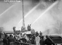 0371062 © Granger - Historical Picture ArchiveNYC: FIRE, 1909.   Firemen spraying a burning building on 14th Street in New York City. Photograph, 20 December 1909.