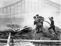 0408147 © Granger - Historical Picture ArchiveCONEY ISLAND: DREAMLAND.   Firefighters fighting the fire that destroyed Dreamland amusement park at Coney Island, Brooklyn, New York. Photograph, May 1911.