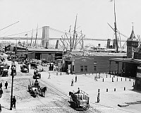 0409544 © Granger - Historical Picture ArchiveNEW YORK: SOUTH STREET.   View of South Street in lower Manhattan with the Brooklyn Bridge in the background, New York. Photograph, c1900.