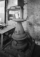 0409601 © Granger - Historical Picture ArchivePOTBELLY STOVE.   A potbelly stove located at 203 Front Street, New York. Photograph, 20th century.