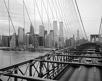 0409613 © Granger - Historical Picture ArchiveBROOKLYN BRIDGE, 1982.   View from the bridge showing suspension system, superstructure and Lower Manhattan, New York. Photograph by Jet Lowe, 1982.