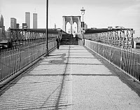 0409614 © Granger - Historical Picture ArchiveBROOKLYN BRIDGE, 1982.   View of the Brooklyn Bridge, including steps to the pedestrian promenade and World Trade Center in the distance, New York. Photograph by Jet Lowe, 1982.