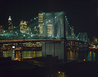 0409615 © Granger - Historical Picture ArchiveBROOKLYN BRIDGE, 1982.   Northwest view of the Brooklyn Bridge and Lower Manhattan at night, New York. Photograph by Jet Lowe, 1982.
